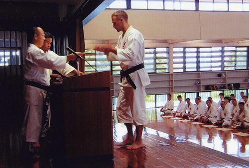 Robert Liljeblad receives his inkajo (dan certificate) at his grading to seikenshi 4 dan at hombu.