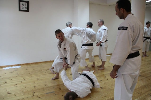 Åke-sensei explains ura gassho gatame to Piyush